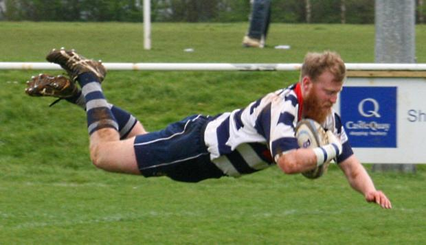 Chris Phillips dives over for the second of his try treble