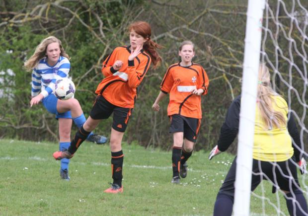 Oxford City's Emily Green gets a shot past Crowmarsh defender Eve Burgess. Soon afterwards, Green scored City's winner