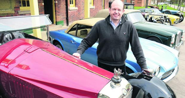 Bicester Heritage managing director Daniel Geoghegan with a 1924 Vauxhall 30-98 and other classic cars