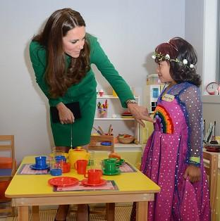 Bicester Advertiser: The Duchess of Cambridge meets Bailey Taylor, six, during her visit to the Rainbow Place Children's Hospice in Hamilton, New Zealand