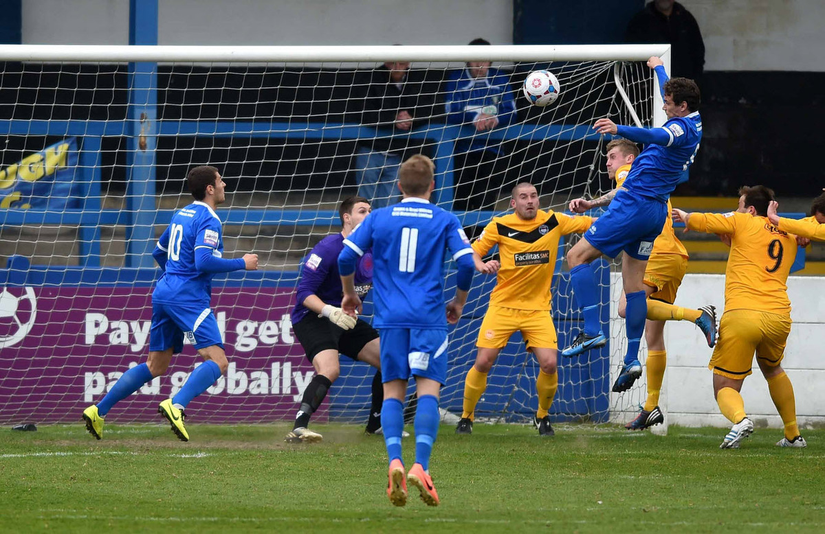 Gainsborough Trinity's Greg Young rises highest above a static Oxford City defence to head his side into the lead