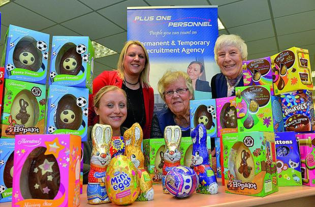 Handing over Easter eggs to the Bicester Foodbank are, from left, Katy Wintour and Claire Randall from Plus One Personnel in Bicester, with Janet Ray, foodbank project manager and Ann Beveridge a foodbank volunteer accepting the donation