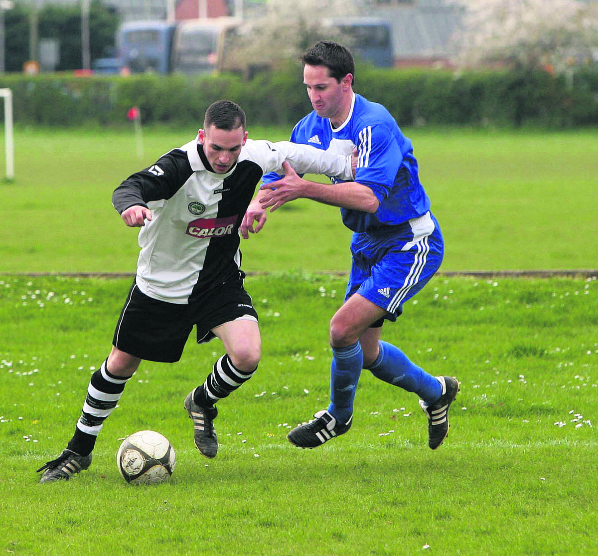 Oakley United scorer Shayne Almond (left) holds off Tom Chase during their 2-0 win at Horspath which boosted their title bid