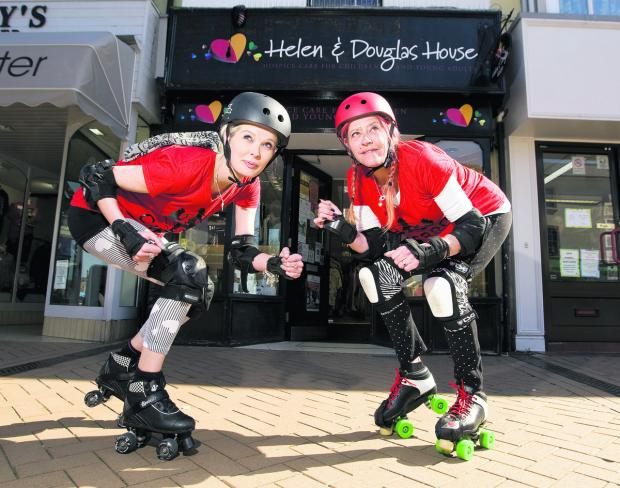 Code Red Roller Derby team members Selina Thomas and Sharon Greenwood at Helen and Douglas House charity shop in Bicester