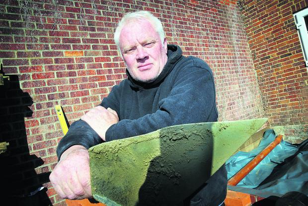 Bricklayer Simon Wells says he is so busy he is having to turn work away. Picture: OX66598 Damian Halliwell