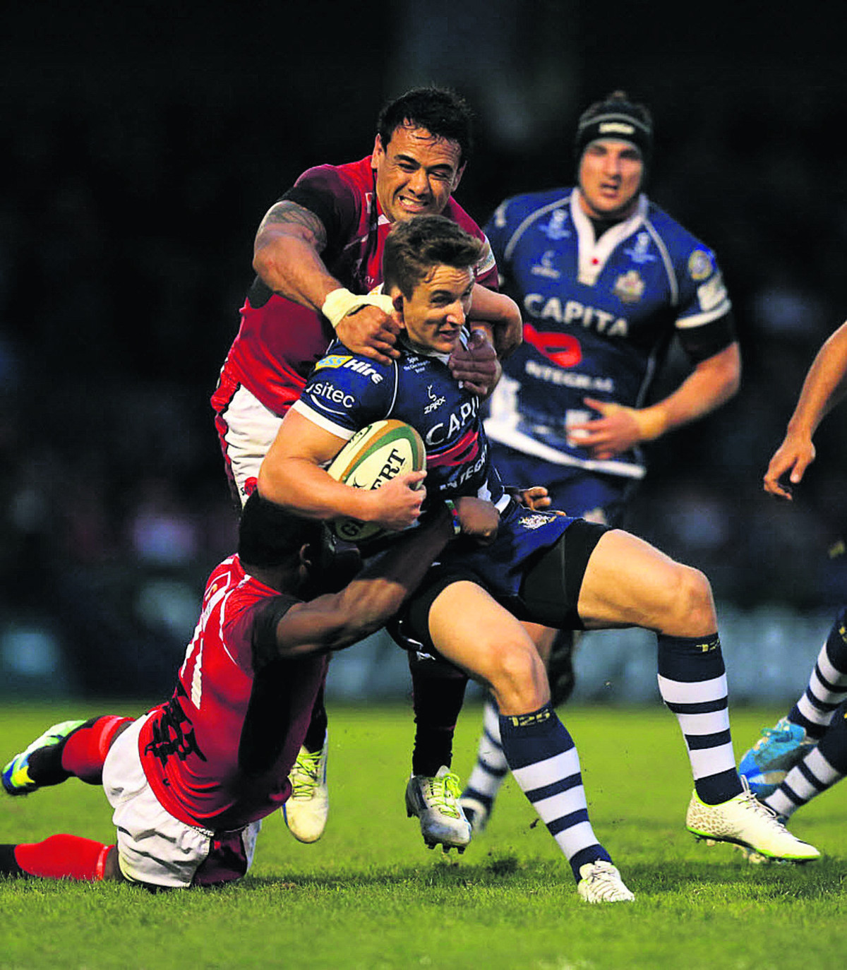 London Welsh's Daniel Browne and Joe Ajuwa get to grips with Bristol's George Watkins at the Memorial Ground last night