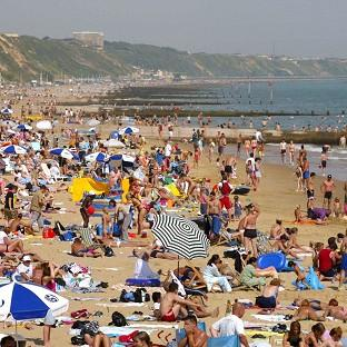 A survey has revealed that many Britons spend time at work booking and researching holidays