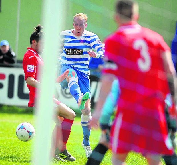 Bicester Advertiser: Andy Ballard squeezes the ball in from a narrow angle to equalise for Oxford City