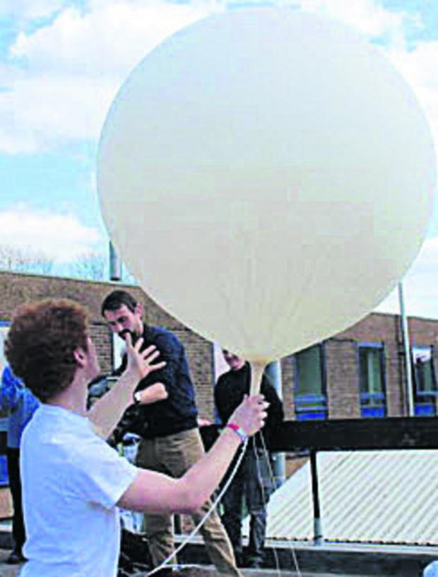 Bicester Advertiser: University of Nottingham's PhysSoc society launching the balloon on Friday