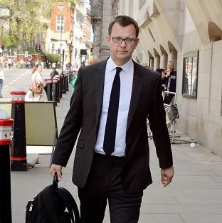 Andy Coulson denies a charge of