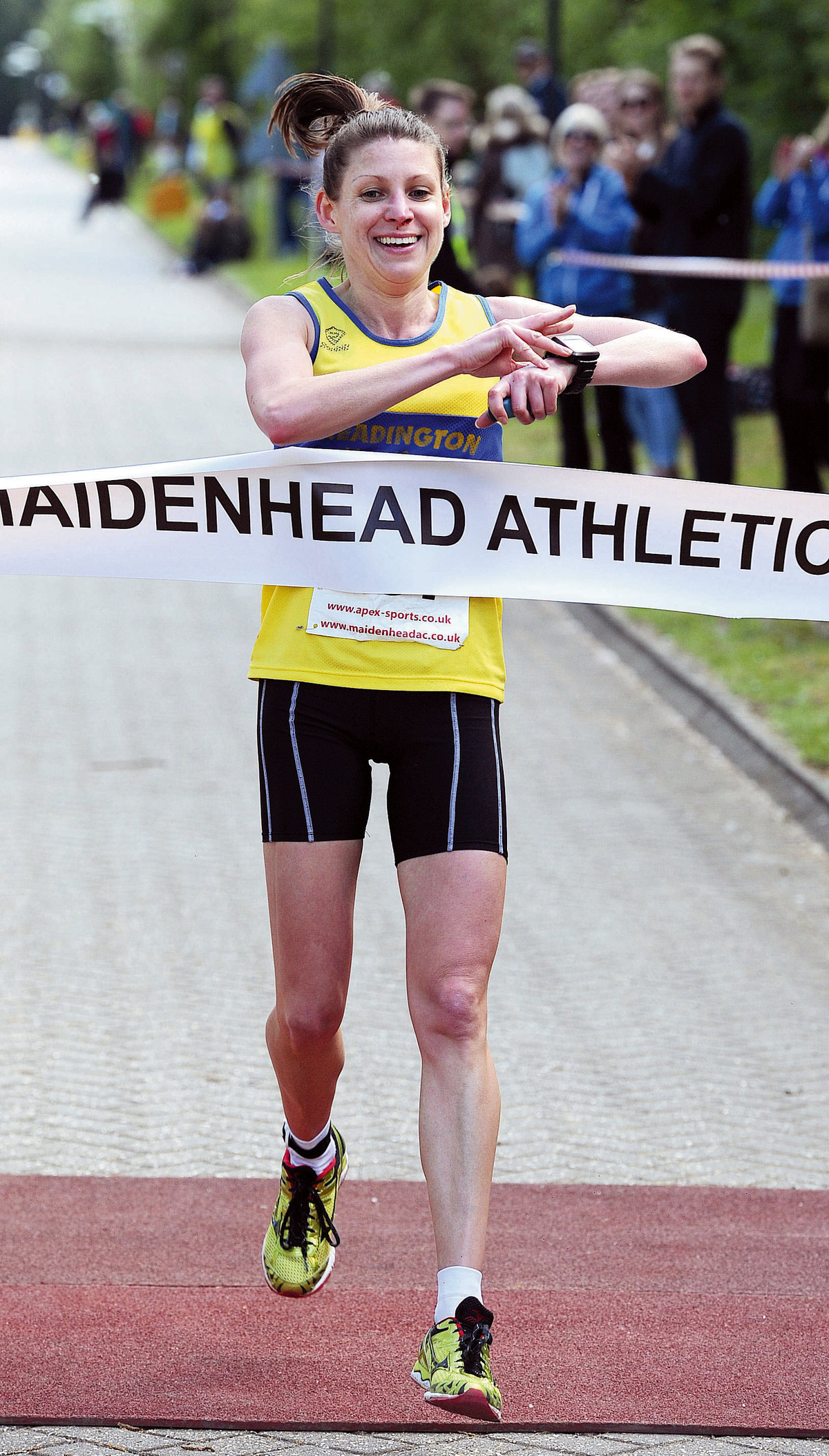 Headington Road Runners' Diane Moore crosses the line to win the Maidenhead Easter 10    		          Picture: Baylis Media Ltd