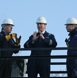 Prime Minister David Cameron (centre) visiting a shale drilling plant oil depot