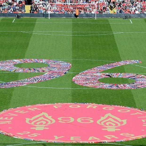 Bicester Advertiser: Fans' scarves make up a 96, filling the centre circle before the Hillsborough 25th Anniversary Memorial Service at Anfield Stadium, Liverpool