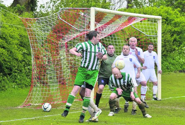 Bicester Advertiser: OCC's Chris Jones with a defensive header. Pictures: OX66725 Denis Kennedy