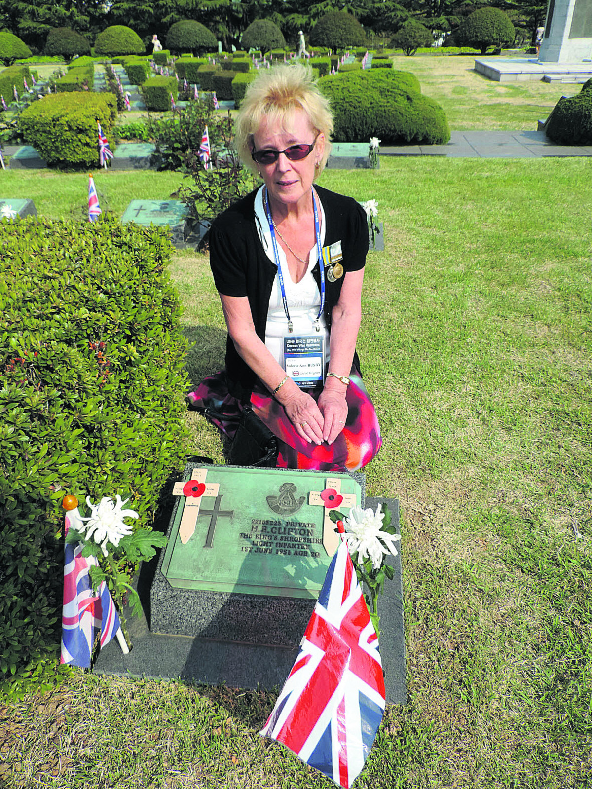 Val Busby at the graveside in South Korea of her uncle Herbert Clifton