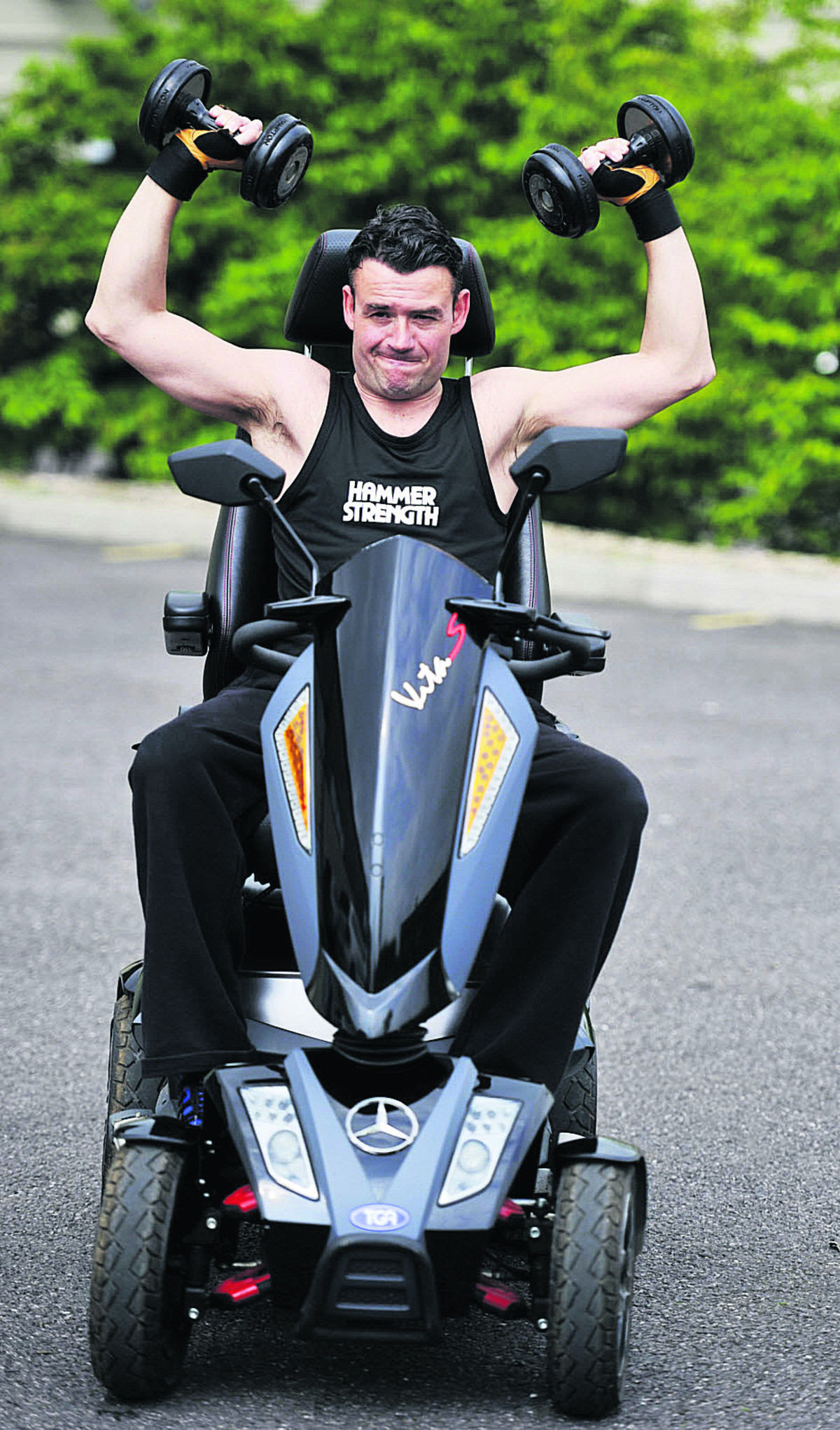 Bruce Barrett on his mobility scooter outside the gym where he works out.  Picture: OXnnnn Mark Hemsworth