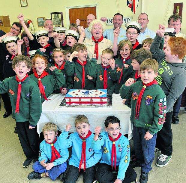 Beavers, Cubs and Scouts give a cheer at the reopening of the refurbished 1st Bicester Scout HQ, along with Scout leaders and DHL staff