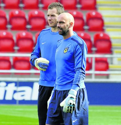 Oxford United's goalkeeping coach Wayne Brown (right) with Ryan Clarke