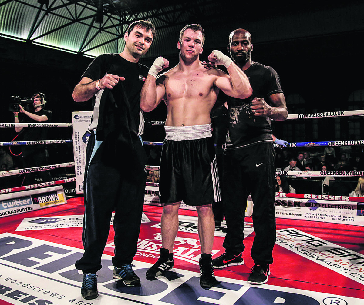 Oxford heavyweight Matthew Reeves is flanked by trainer Dennis Hysenbeli (left) and co-trainer Ray Webb after his latest victory