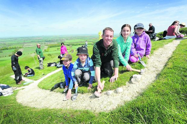 Bicester Advertiser: White sutff: National Trust ranger Andy Foley with, from left, Aidan Slark, nine, Thomas Robinson, eight, Abbie and Jodie Slark, 11 and seven respectively
