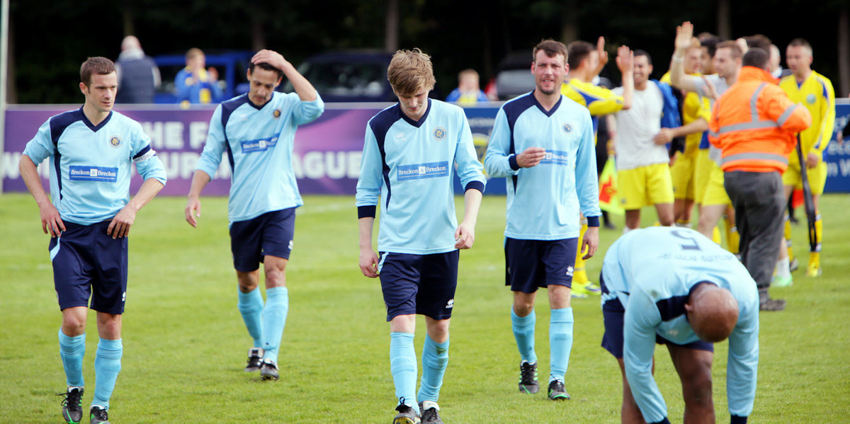 Ardley United's dejected players troop off the pitch as Ascot celebrate
