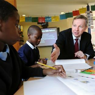 Education Secretary Michael Gove speaks to pupils at Durand Academy Primary School