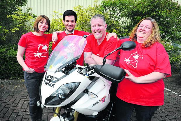 Bicester Advertiser: Organiser Paul Long on the bike, with from left, wife Angie, and Shaun Clark and Sharon Ryan who will be manning checkpoints. Picture: OX67012 Jon Lewis