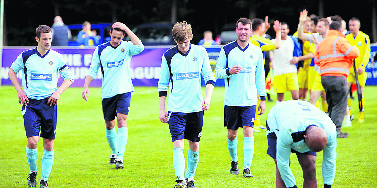 Ardley's players troop off after their final defeat, as Ascot's players celebrate
