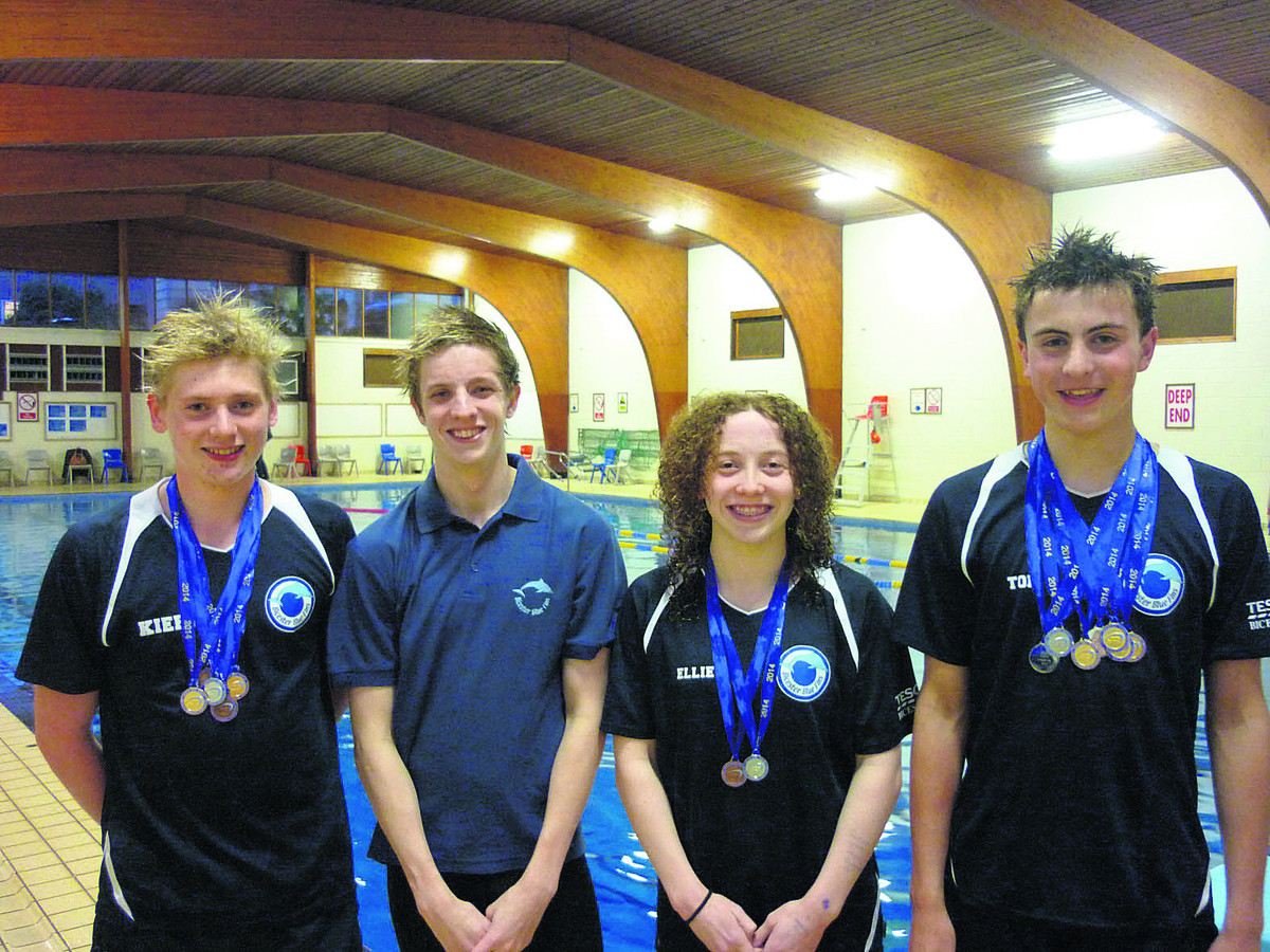 Bicester Blue Fins show off their medals. From left: Kieran Bird, Tom Nolte, Ellie Falkner and Tom Thornley. Liam O'Brien is not in picture