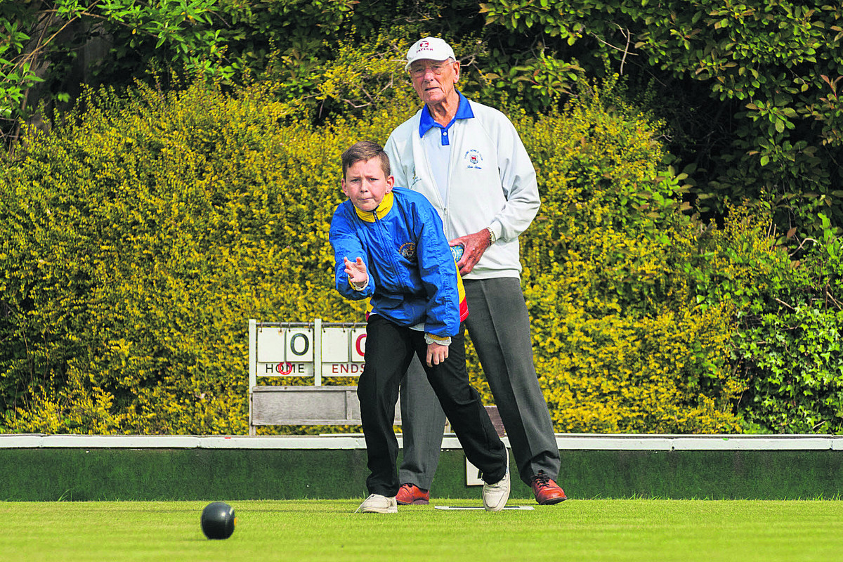 Bicester's Brandon King, 13, in action against Thame's Ron Slater, 87, in the Oxfordshire Two-Wood Singles competition