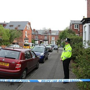 Bicester Advertiser: Police at the scene in Wake Road, Sheffield, where five members of the same family, including three young children, died in a house fire