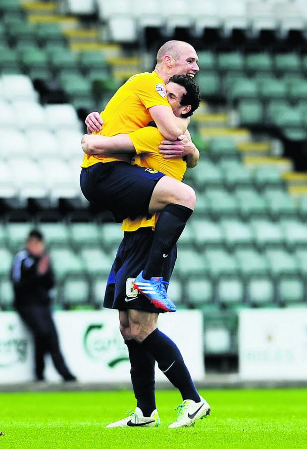 Bicester Advertiser: Jake Wright (right) hugs James Constable after the striker scored at Plymouth last season. The duo could both stay at Oxford next season