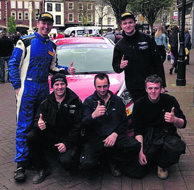 The Major Motorsport team. Standing (from left): co-driver Carl Williamson and driver Gus Greensmith. Kneeling: team manager Simon Major with mechanics Henry Whitfield and Matt Faulkner