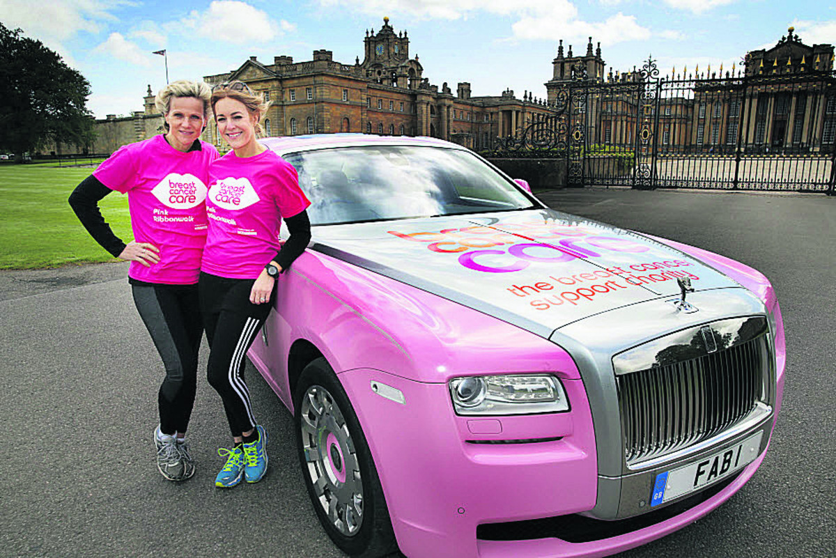 Linda Barker, left, and Helen Fospero at Blenheim Palace with a specially adapted Rolls-Royce Ghost to promote the Pink Ribbonwalk