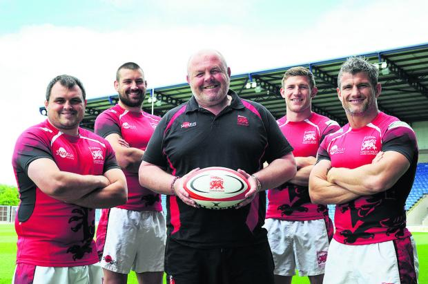 Bicester Advertiser: London Welsh at their pre-match press conference at the Kassam Stadium yesterday ahead of their Greene King IPA Championship play-off semi-final. From left: Nathan Trevett, Matt Corker, head coach Justin Burnell, Alan Awcock and Tom May