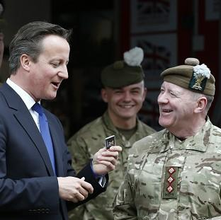 Bicester Advertiser: Prime Minister David Cameron met with members of the Armed Forces during his visit to Glasgow on Thursday
