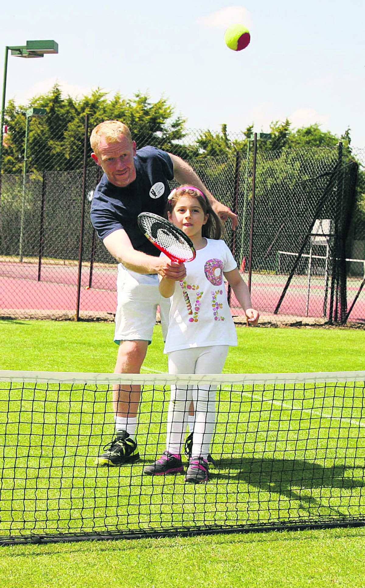 North Oxford head coach Chris Hampton shows seven-year-old Rita Iannacci the ropes during a free taster session