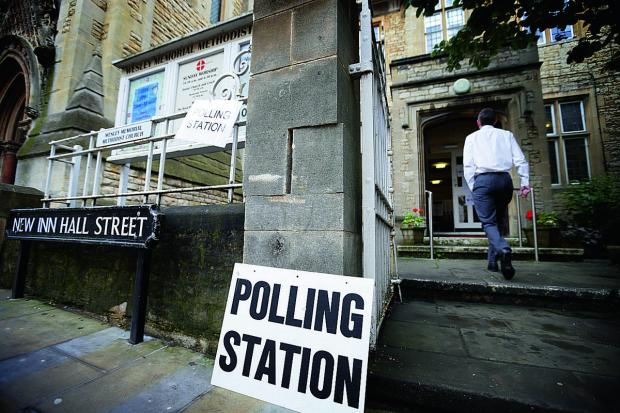 Voters arrive at Wesley Memorial Church polling station in Oxford city centre.