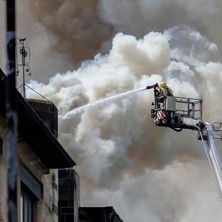 Bicester Advertiser: Firefighters tackle the blaze at Glasgow School of Art's Charles Rennie Mackintosh building (PA/David Barz)