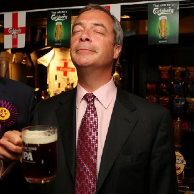 Bicester Advertiser: Ukip leader Nigel Farage enjoys a pint in the Hoy and Helmet pub in South Benfleet, Essex, as his party makes election gains