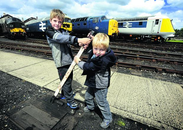 Joshua Hogg, eight, and his four-year-old brother Nathan with a line-up of locomotives at Didcot Railway Centre's Diesel Gala on Saturday	       Picture: OX67427 David Fleming