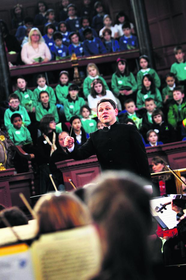 Bicester Advertiser: John Traill, who conducts the county's youth orchestra