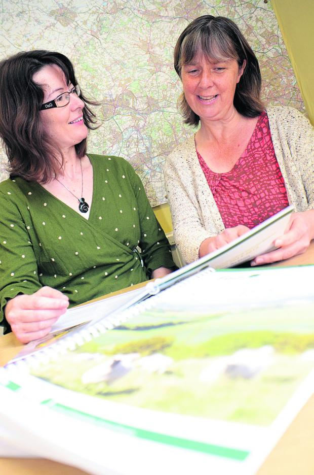Bicester Advertiser: Chilterns Conservation Board infomation officer Claire Forrest, left, and countryside officer Cath Daly look over the management plan