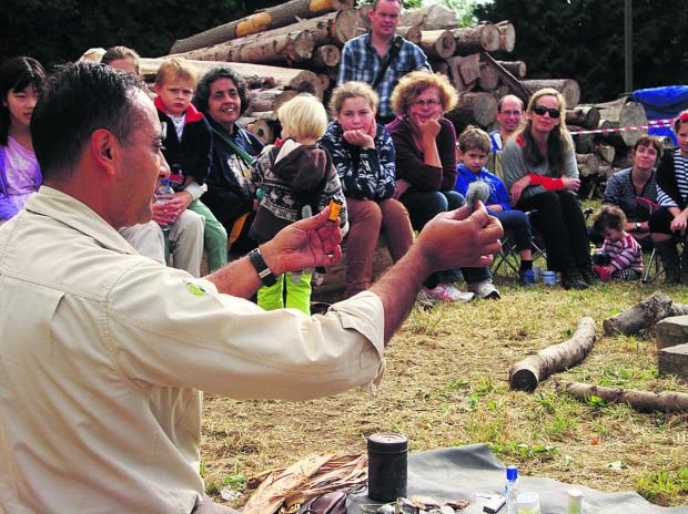 Bicester Advertiser: Manse Ahmed takes a fire-making demonstration at last year's RSPB Big Wild Sleepout in Wytham Woods