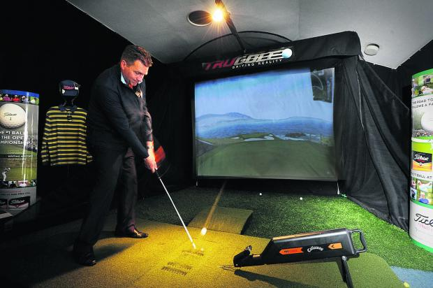 North Oxford professional Lee Jackson uses the golf simulator which in this instance is portraying the seventh hole at the famous Pebble Beach course in the United States