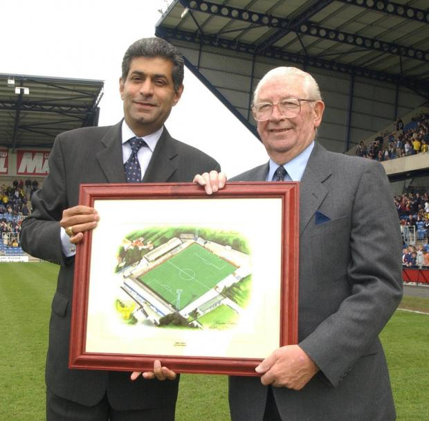Bicester Advertiser: Firoz Kassam (left), Oxford United's chairman in 2002, presents Jack Casley with a painting of the old Manor Ground to mark his services to the club