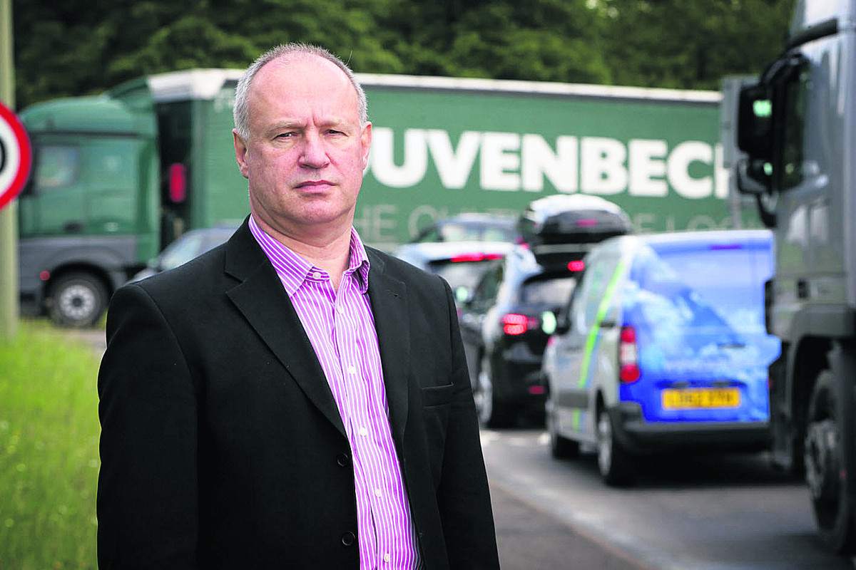Chairman of Oxfordshire Chamber of Commerce, Bob Bradley, at the Wolvercote roaundabout on the A40. Picture: OX67623 Damian Halliwell