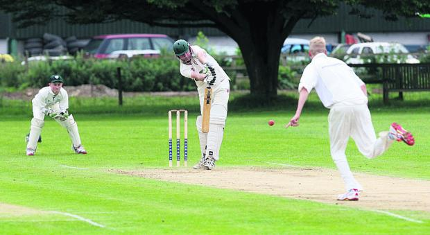 Bicester Advertiser: Oxford & Bletchingdon Nondies' Jon Guthrie takes a single off Jason Cardy  during their four-run win against Abingdon Vale in Division 2