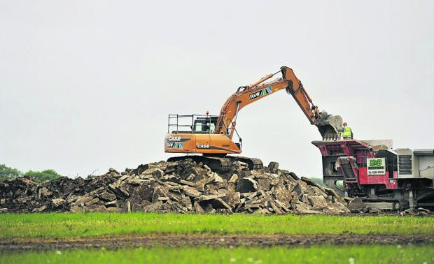 The demolition of part of the runway at the former RAF Broadwell base near Carterton.   Pictures: Mark Hemsworth