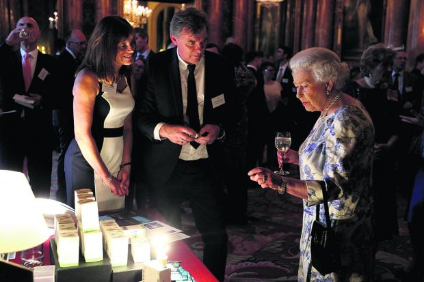 Her Majesty asks Zeta managing director Philip Shadbolt and his wife Dawn whether the firm's energy-efficient lightbulbs would work in Buckingham Palace's ornate chandeliers